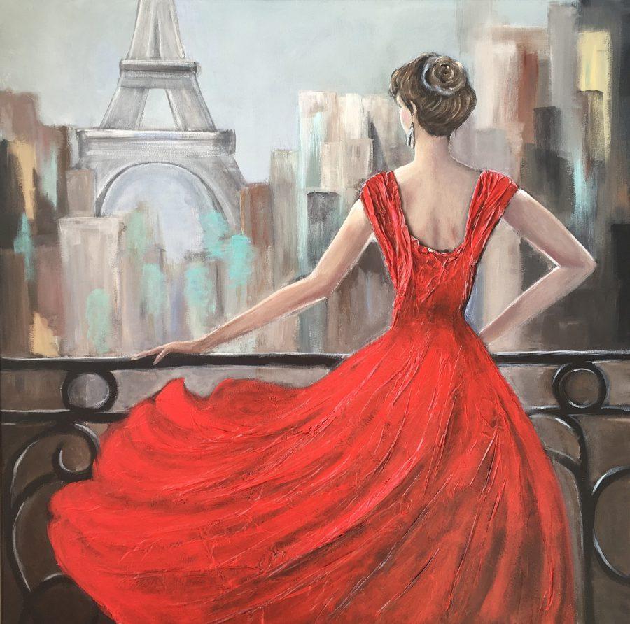 Frau in Kleid vor Eifelturm